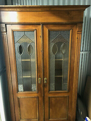 Late 19th century oak bookcase with stained glass in doors