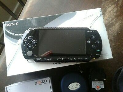 Sony Playstation PSP Bundle. 29 Games. 9 Umd Films. Boxed. Very good condition.