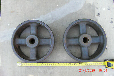 Vintage Pair Of  Industrial Cast Iron Wheels. Condition is used.