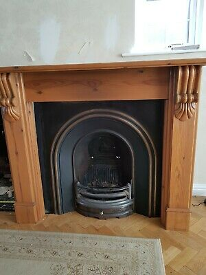 Cast Iron Fire Place With Wooden Surround