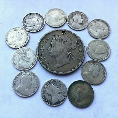 Lots of 12 Straits Settlements 5, 50 cents(with a hole) silver coins, circulated