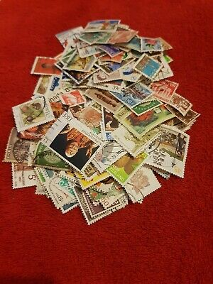 300 + World Stamps ( un-sorted ) FREE POSTAGE