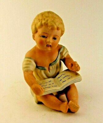 Antique or Vintage Piano Baby Statue Figure Bisque Girl Sitting with Book
