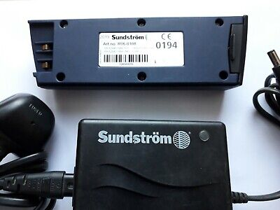 SUNSTROM CHARGER AND BATTERY. Used but good condition. Battery 1 month old.