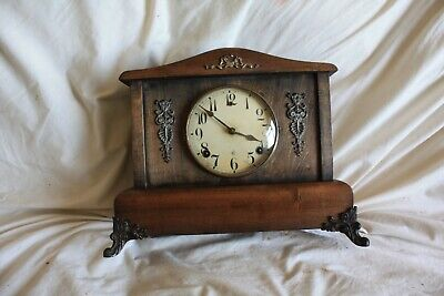 vintage ,,Mantle Clock Ansonia Wood ,, chimes and rings.. good working order..