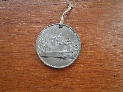 UK medallion - 1886 Edinburgh International Exhibition. 35 mm approx diam. Holed