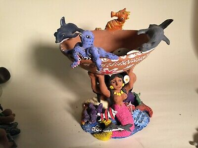 Josefina Aguilar fantasy basin with mermaids, fish and who know's what