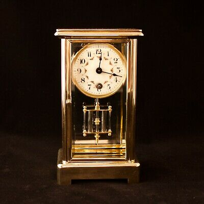 Brass cased mantel clock with faux mercury pendulum
