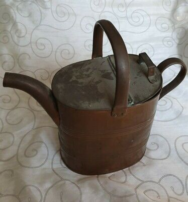 """Vintage retro mid-century brass watering can complete with lid.  Approx 11"""" tall"""