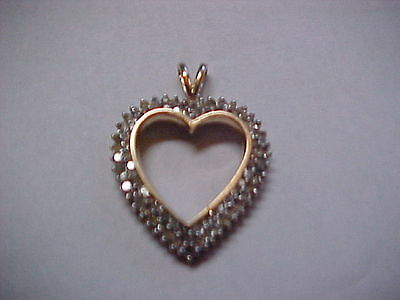 1 Carat Diamond Heart 1.2 Inches Long 7/8Th Inch Wide 10K Gold Weighs 4.5 Grams
