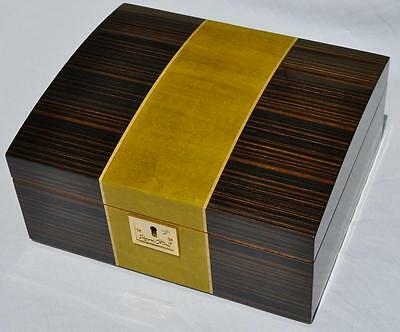 The Denine 50 Cigar Star Humidor Canadian Maple dyed green contrast Zebra Wood.