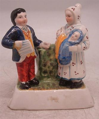 Staffordshire Pottery Figure - Man Baptising two Babies