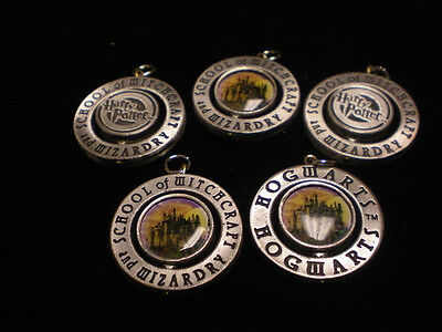 5 CUTE HARRY POTTER HOGWARTS pewter CHARMS aprox 1 inch CENTER TURNS