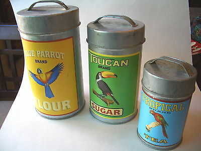 ROUND TIN NESTING CANISTERS WITH TROPICAL BIRDS DESIGNS ON THEM