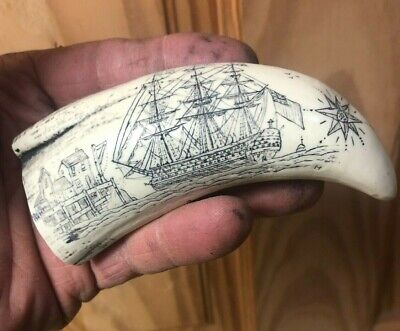Scrimshaw sperm whale tooth replica. two angels over British ship HMS Victory