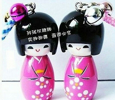 A pair of Japanese the Kokeshi small Wooden Doll Handset to hang a piece