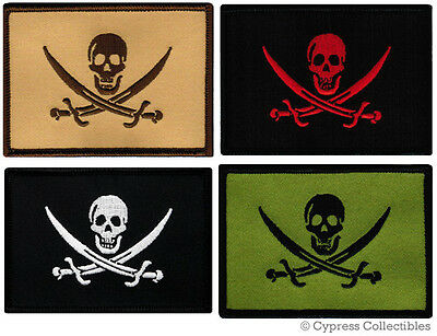 LOT FOUR (4) PIRATE JOLLY ROGER PATCHES iron-on embroidered SKULL SWORDS FLAGS