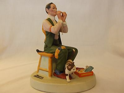 "Danbury Mint Norman Rockwell Porcelain Figurine ""Man Threading A Needle"""