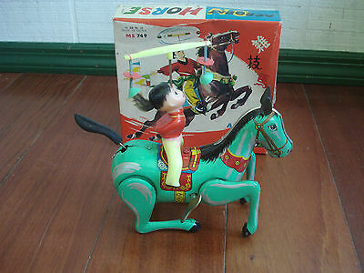 VINTAGE TIN WIND UP TOY ACROBAT ON HORSE CLOCKWORK