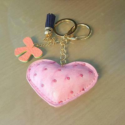 Leather padded keyring, various colourful designs. Heart dog cat star clover