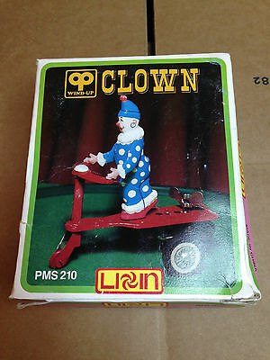 Chinese Wind-Up Tin Toy Clown on Red Scooter PMS 210