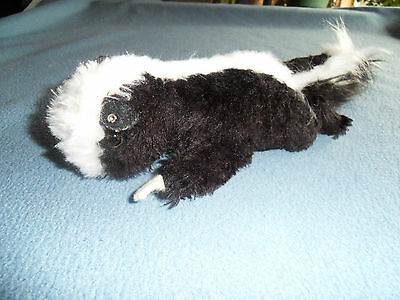 Steiff skunk, cosy skunk, w. button,old, made in Germany 322