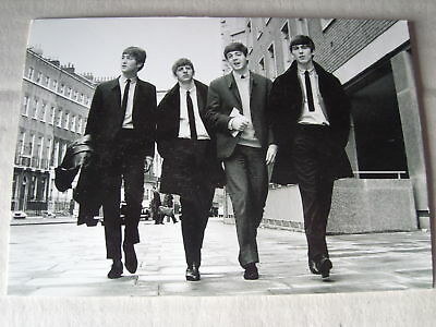 POST CARD FEATURING THE BEATLES new but not sealed