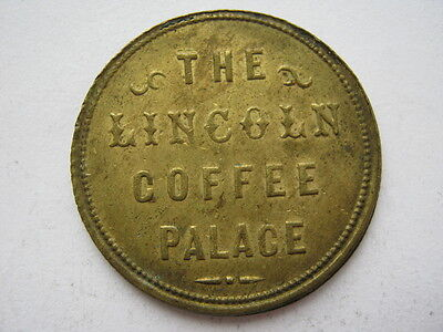 The Lincoln Coffee Palace Penny token, brass 26mm.