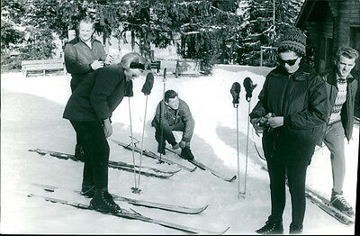 Vintage photo of Princess Beatrix skiing with people. -