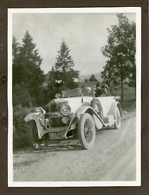 Germany, German Tourists posing with their car  Vintage silver print. Vintage ca