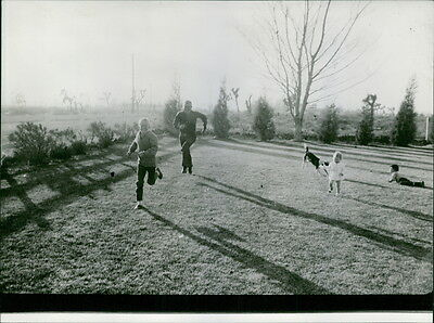 Vintage photo of Joe Walker playing with his children in garden.  -