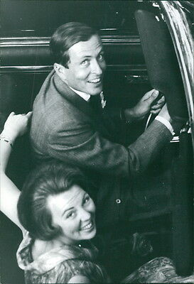 Vintage photo of Beatrix and Claus of the Netherlands smiling in car. -
