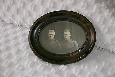 """Antique Oval Tin Framed  Picture of 2 Service Air Men Under Glass  7"""" x 5 1/2"""""""