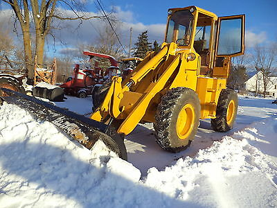 FORD  A62 LOADER  diesel 4x4  12 feet snow blade  , newholland motor  , Cat!