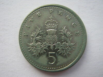 1990 error 5 Pence coin, off centre and without collar.