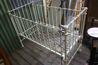 A Victorian Cast Iron Cot Bed with Sprung Base