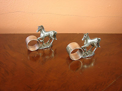 Pair of antique figural silver plate napkin rings with prancing horse