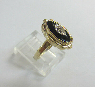 14K Yellow Gold Ring with Oval Onyx and Petite Diamond