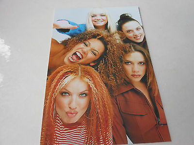 SPICE GIRLS picture the girls huddled togetherhaving a great time
