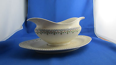 ancienne sauciere en porcelaine art deco  epoque 1945 decor floral