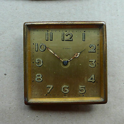 Swiss 8 day brass clock with stand, working order, 72mm square.