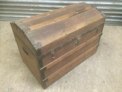 Old antique dome top strapped and banded steamer storage trunk