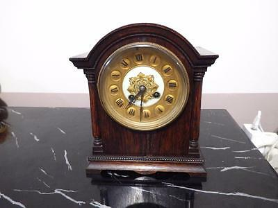 French Mantel clock set in an ornately designed wooden case circa 1930