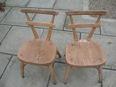 Matching pair of old vintage early Ercol white spot children's stacking chairs