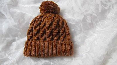 HAND KNITTED CHLDS BOB HAT CABLED RUST AGE 0-3mths3-6mths6-12mths 1-2 &3-4 yrs