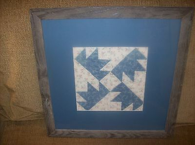 framed quilt square from 1920s