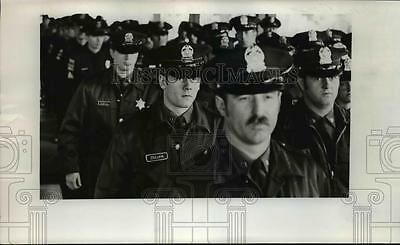 1975 Press Photo Police officers stant at attention during Eugene rite