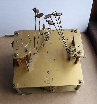 Vintage Smiths Empire chiming clock movement for parts or repair, incomplete.