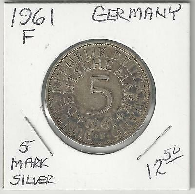 A LARGE SILVER 5 MARK COIN from GERMANY DATING 1961F