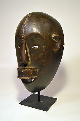 A Fine Sukuma African mask on display stand, African Tribal Art